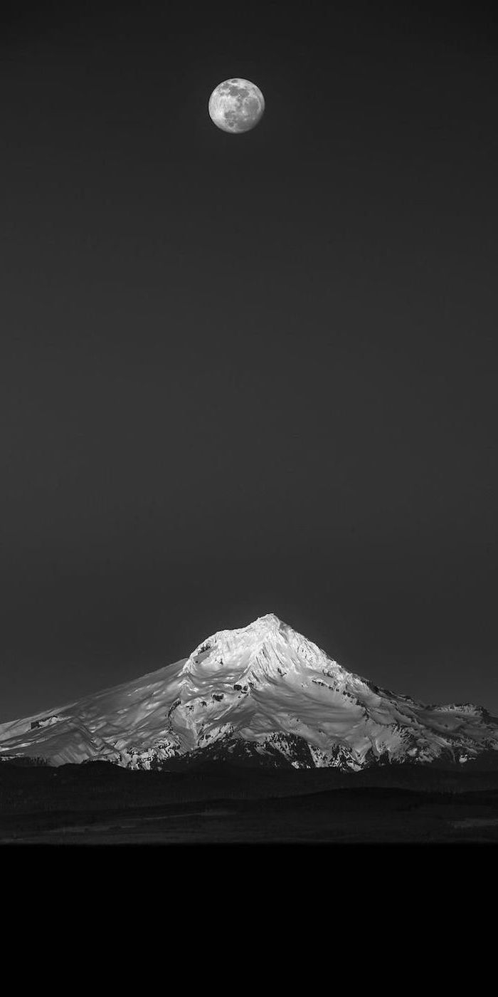 black and white photo of a snowy mountain landscape red aesthetic wallpaper full moon in the black sky