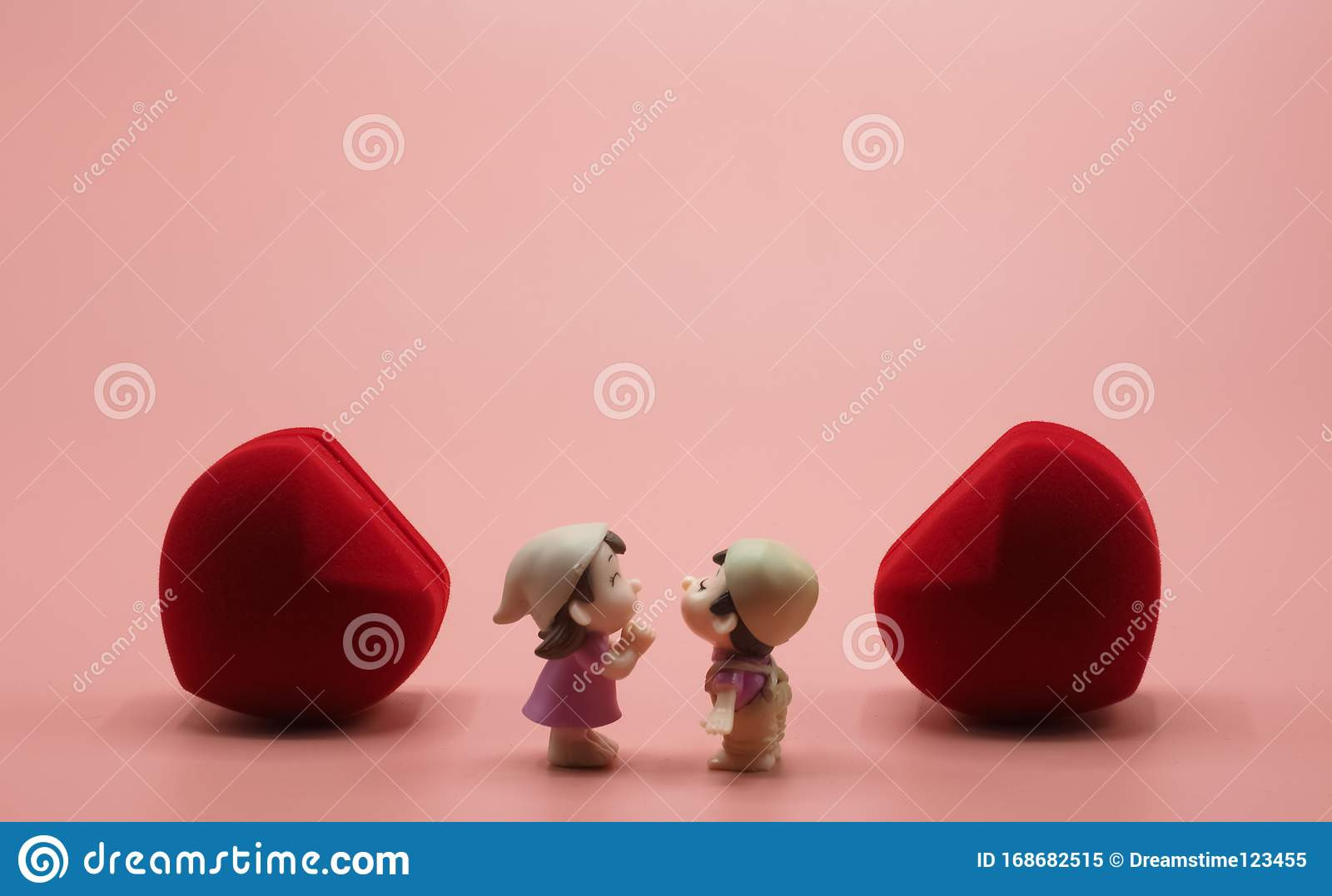 pink background wallpaper has two red heart middle girl boy doll toy romantic happy lovers kissing fourteen feb
